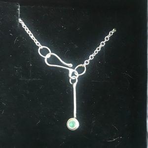 Ankle bracelet, has Emerald stone in bezel setting.