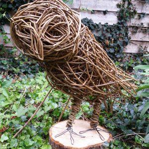 willow owl sculpture standing log